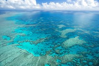 In this undated photo provided by the Great Barrier Reef Marine Park Authority, Hook Reef, in the Whitsunday region, is viewed from the air off the coast of Australia.  (Jumbo Aerial Photography/Great Barrier Reef Marine Park Authority via AP)