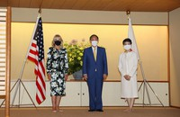 U.S. first lady Jill Biden, left, Japanese Prime Minister Yoshihide Suga, center, and his wife Mariko pose for a photo on July 22, 2021, at Akasaka Palace in Tokyo. (Pool photo)