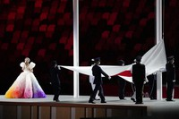 The Japanese flag is raised during the opening ceremony in the Olympic Stadium at the 2020 Summer Olympics, on July 23, 2021, in Tokyo, Japan. (AP Photo/Ashley Landis)