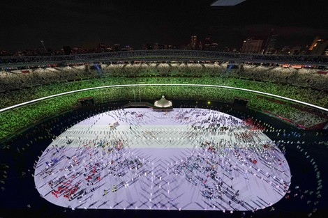 Athletes are introduced during the opening ceremony at the Olympic Stadium at the 2020 Summer Olympics, on July 23, 2021, in Tokyo. (AP Photo/Morry Gash)
