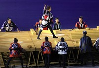Actors and dancers dressed as carpenters perform during the opening ceremony of the Tokyo Games, at the Japan National Stadium on July 23, 2021. (Mainichi/Naotsune Umemura)