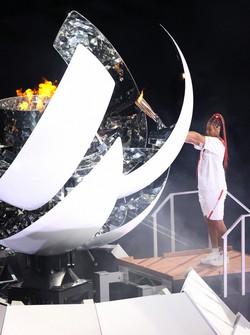 Naomi Osaka is seen lighting the cauldron at the Japan National Stadium during the Tokyo Olympic opening ceremony on the night of July 23, 2021. (Mainichi/Junichi Sasaki)