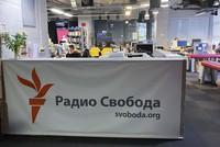 In this Jan. 27, 2021 file photo, journalists work at a newsroom of Radio Free Europe/Radio Liberty's Moscow Bureau in Moscow, Russia. (Anton Sergienko, RFE/RL via AP)