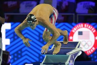In this June 19, 2021 file photo, Michael Andrew participates in the men's 50 freestyle during wave 2 of the U.S. Olympic Swim Trials in Omaha, Nebraska. (AP Photo/Jeff Roberson)