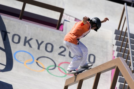 China's Zeng Wenhui trains during a street skateboarding practice session at the 2020 Summer Olympics, on July 23, 2021, in Tokyo. (AP Photo/Markus Schreiber)