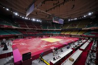People prepare the field of play for judo at the Nippon Budokan ahead of the 2020 Summer Olympics, on July 23, 2021, in Tokyo. (AP Photo/Vincent Thian)