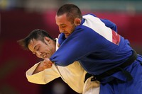 Lukhumi Chkhvimiani of Georgia, right, and Naohisa Takato, of Japan, compete during their men's judo 60kg quarterfinals match at the 2020 Summer Olympics, on July 24, 2021, in Tokyo. (AP Photo/Jae C. Hong)