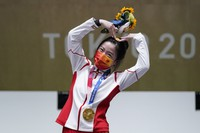 Yang Qian, of China, reacts after winning the gold medal in the women's 10-meter air rifle at the Asaka Shooting Range in the 2020 Summer Olympics, on July 24, 2021, in Tokyo. (AP Photo/Alex Brandon)