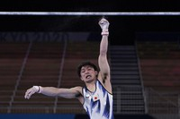 Kohei Uchimura, of Japan, falls from the horizontal bar during the men's artistic gymnastic qualifications at the 2020 Summer Olympics, on July 24, 2021, in Tokyo. (AP Photo/Gregory Bull)