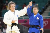 Distria Krasniqi of Kosovo, left, and Funa Tonaki of Japan react after competing in their women's -48kg championship judo match at the 2020 Summer Olympics, on July 24, 2021, in Tokyo, Japan. (AP Photo/Vincent Thian)