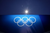 The sun shines above an image of the Olympic rings at Yokohama Baseball Stadium as the venue is prepared for softball competition at the 2020 Summer Olympics, on July 22, 2021, in Yokohama, Japan. (AP Photo/Matt Slocum)