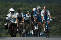 Riders in the breakaway climb during the men's cycling road race at the 2020 Summer Olympics, on July 24, 2021, in Oyama, Japan. (AP Photo/Thibault Camus)