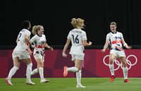 Britain's Ellen White, right, celebrates scoring her side's opening goal during a women's soccer match against Japan at the 2020 Summer Olympics, on July 24, 2021, in Sapporo, Japan. (AP Photo/Silvia Izquierdo)