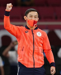 Gold medalist Naohisa Takato of Japan reacts during the medal ceremony for men's -60kg judo at the 2020 Summer Olympics, Saturday, July 24, 2021, in Tokyo, Japan. (AP Photo/Vincent Thian)