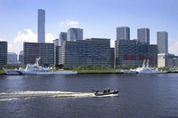 A Japanese Coast Guard boat patrols Tokyo Bay outside of the Olympic athletete's village ahead of the 2020 Summer Olympics, Monday, July 19, 2021, in Tokyo. (AP Photo/Charlie Riedel)