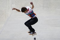 Yuto Horigome of Japan tumbles during competition in the men's street skateboarding finals at the 2020 Summer Olympics, Sunday, July 25, 2021, in Tokyo, Japan. (AP Photo/Jae C. Hong)