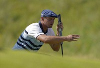 In this July 17, 2021, file photo, United States' Bryson DeChambeau gestures as he lines up his putt on the 2nd green during the third round of the British Open Golf Championship at Royal St George's golf course Sandwich, England. (AP Photo/Alastair Grant, File)