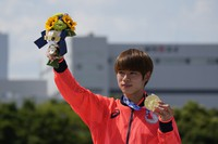 Yuto Horigome of Japan holds his gold medal after the men's street skateboarding finals at the 2020 Summer Olympics, July 25, 2021, in Tokyo, Japan. (AP Photo/Ben Curtis)