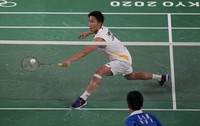 Kento Momota of Japan competes against USA's Timothy Lam during men's singles Badminton match at the 2020 Summer Olympics, July 25, 2021, in Tokyo, Japan. (AP Photo/Markus Schreiber)