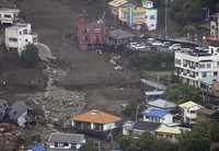 This aerial photo taken from a Mainichi Shimbun helicopter on July 5, 2021, shows the site of the large July 3 mudslide that swept away many buildings in Atami, Shizuoka Prefecture. (Mainichi)