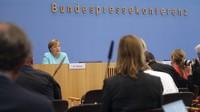 German Chancellor Angela Merkel speaks, during her annual summer news conference in Berlin, Germany, on July 22, 2021. (Wolfgang Kumm/dpa via AP)