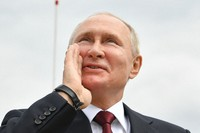 Russian President Vladimir Putin shouts to spectators as he leaves the Navy Day parade in St. Petersburg, Russia, on July 25, 2021. (Alexei Nikolsky, Sputnik, Kremlin Pool Photo via AP)