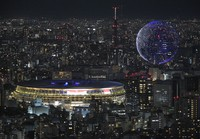 In this July 23, 2021, file photo, drones fly over the National Stadium during the opening ceremony of 2020 Tokyo Olympics is seen from Shibuya Sky observation deck in Tokyo, Japan. (Mainichi)