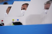 Judges watch the men's floor exercise during the artistic gymnastics qualifications, separated by panels as a preventive measure against the coronavirus, at the 2020 Summer Olympics, on July 24, 2021, in Tokyo. (AP Photo/Gregory Bull)