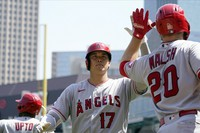 Los Angeles Angels' Shohei Ohtani (17) high-fives with Jared Walsh after Ohtani's solo home run off Minnesota Twins pitcher Danny Coulombe in the sixth inning of a baseball game, on July 25, 2021, in Minneapolis. (AP Photo/Jim Mone)