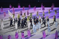 The refugee team carry the Olympic flag during the opening ceremony in the Olympic Stadium at the 2020 Summer Olympics, on July 23, 2021, in Tokyo, Japan. (Dylan Martinez/Pool Photo via AP)