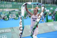 Kristian Blummenfelt of Norway celebrates as he crosses the finish line to win the gold medal during the men's individual triathlon at the 2020 Summer Olympics, on July 26, 2021, in Tokyo, Japan. (AP Photo/Jae C. Hong)