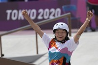 Momiji Nishiya of Japan reacts after winning the women's street skateboarding finals at the 2020 Summer Olympics, on July 26, 2021, in Tokyo, Japan. (AP Photo/Ben Curtis)