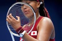 Naomi Osaka, of Japan, adjusts her racket during a second-round tennis match against Viktorija Golubic, of Switzerland, at the Summer Olympics, on July 26, 2021, in Tokyo, Japan. (AP Photo/Patrick Semansky)