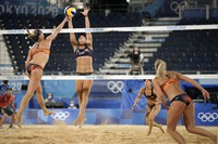 Madelein Meppelink, left, of the Netherlands, takes a shot as Liliana Fernandez Steiner, second from left, of Spain, defends during a women's beach volleyball match at the 2020 Summer Olympics, on July 25, 2021, in Tokyo, Japan. (AP Photo/Felipe Dana)