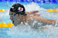 Daiya Seto, of Japan, swims in a heat during the men's 200-meter butterfly at the 2020 Summer Olympics, on July 26, 2021, in Tokyo, Japan. (AP Photo/Petr David Josek)