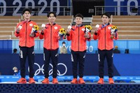 Japan's artistic gymnastics men's team, rleft to right, Daiki Hashimoto, Kazuma Kaya, second right, Takeru Kitazono and Wataru Tanigawa celebrate after winning the silver medal at the 2020 Summer Olympics, on July 26, 2021, in Tokyo. (AP Photo/Gregory Bull)