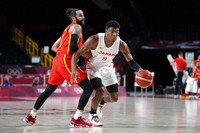 Japan's Rui Hachimura (8) drives past Spain's Rudy Fernandez (5) during a men's basketball preliminary round game at the 2020 Summer Olympics in Saitama, Japan, on July 26, 2021. (AP Photo/Charlie Neibergall)