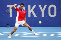Novak Djokovic, of Serbia, returns to Jan-Lennard Struff, of Germany, during second round of the tennis competition at the 2020 Summer Olympics, on July 26, 2021, in Tokyo, Japan. (AP Photo/Patrick Semansky)