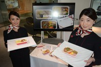 Japan Airlines Co. employees show in-flight meals the company has launched for online sale, in Tokyo's Shinagawa Ward on July 21, 2021. (Mainichi/Tadakazu Nakamura)