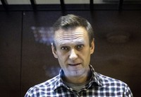 In this Feb. 20, 2021 file photo, Russian opposition leader Alexei Navalny looks at photographers in the Babuskinsky District Court in Moscow, Russia. (AP Photo/Alexander Zemlianichenko)
