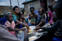 Paska Itwari Beda, the young mother of five children, shares a meal with her family at her home in Juba, South Sudan, on May 27, 2021. (AP Photo/Adrienne Surprenant)