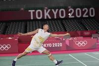 Kento Momota of Japan competes against USA's Timothy Lam during men's singles Badminton match at the 2020 Summer Olympics, on July 25, 2021, in Tokyo. (AP Photo/Dita Alangkara)
