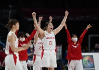 Japan players celebrate their win in the women's basketball preliminary round game against France at the 2020 Summer Olympics, on July 27, 2021, in Saitama, Japan. (AP Photo/Charlie Neibergall)