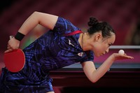 Japan's Mima Ito competes during the table tennis women's singles third round match against Portugal's Fu Yu at the 2020 Summer Olympics, on July 27, 2021, in Tokyo. (AP Photo/Kin Cheung)