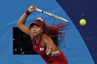 Naomi Osaka, of Japan, plays Marketa Vondrousova, of the Czech Republic, during the third round of the tennis competition at the 2020 Summer Olympics, on July 27, 2021, in Tokyo. (AP Photo/Seth Wenig)