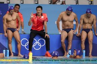 Japan's head coach Yoji Omoto talks with his team during a preliminary round men's water polo match against the United States at the 2020 Summer Olympics, on July 25, 2021, in Tokyo. (AP Photo/Mark Humphrey)