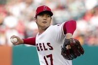 Los Angeles Angels starting pitcher Shohei Ohtani throws to the plate during the first inning of a baseball game against the Colorado Rockies on July 26, 2021, in Anaheim, Calif. (AP Photo/Mark J. Terrill)