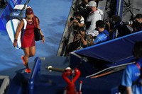 Naomi Osaka, of Japan, leaves center court after being defeated by Marketa Vondrousova, of the Czech Republic, during the third round of the tennis competition at the 2020 Summer Olympics, on July 27, 2021, in Tokyo, Japan. (AP Photo/Seth Wenig)