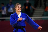 Nora Gjakova of Kosovo celebrates after defeating Sarah Leonie Cystique of France in their women's -57kg judo final match, at Summer Olympics in Tokyo, Japan, on July 26, 2021. (AP Photo/Vincent Thian)