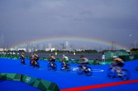 A rainbow appears as athletes compete in the bike leg of the women's individual triathlon competition at the Summer Olympics, on July 27, 2021, in Tokyo, Japan. (AP Photo/David Goldman)